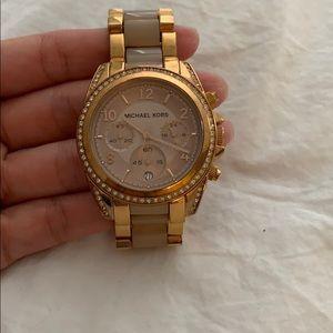 Rose gold Michael Kors diamond faced watch